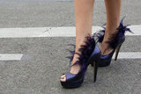 Feather-adorned heels were made for outfitting showstopping style.
