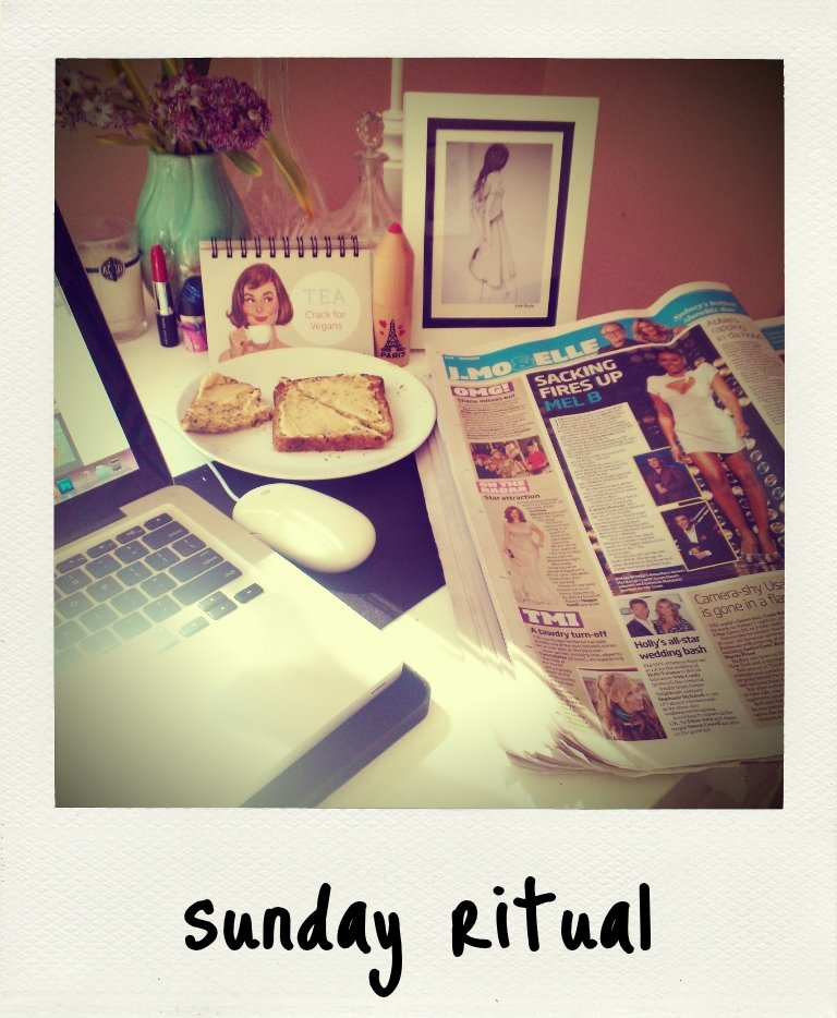 Welcome to my Sunday ritual. Toast with hummus, the Sunday papers (any breaking news, I've gotta be on it!) and my trusty laptop.