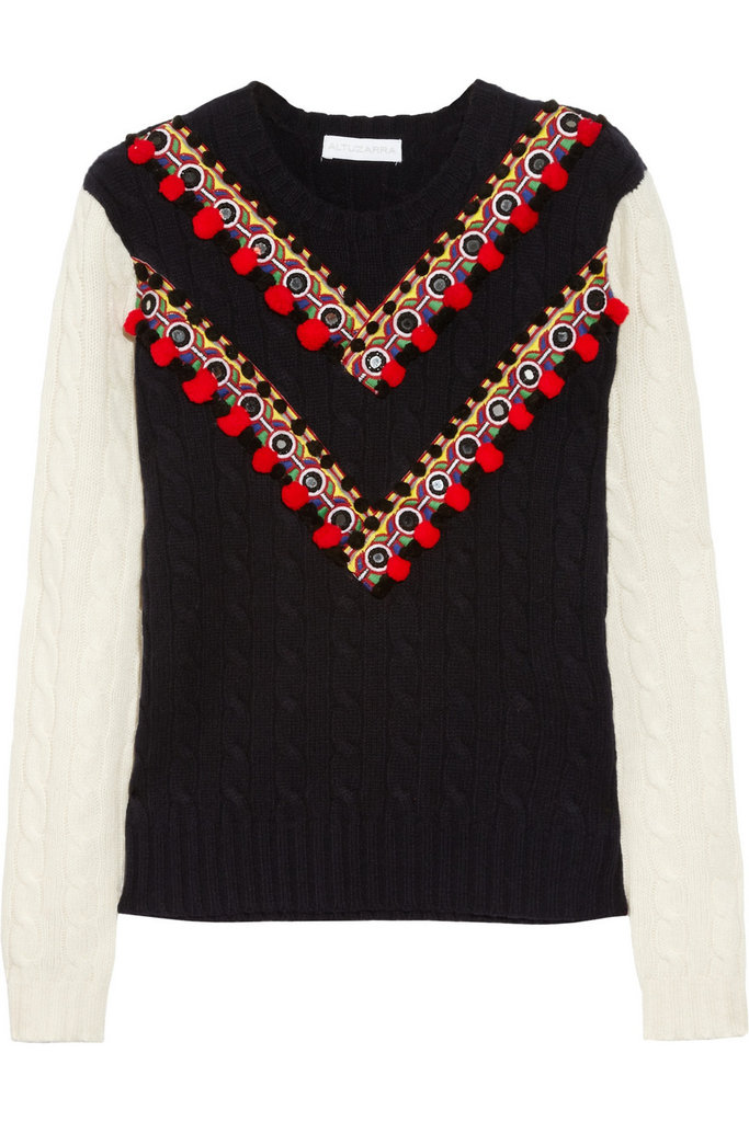 The embellishment on this statement-making Altuzarra Venise Cable-Knit Sweater ($1,125) draws the eye to your bustline — so even though you're covered up, you'll still hold ample attention.