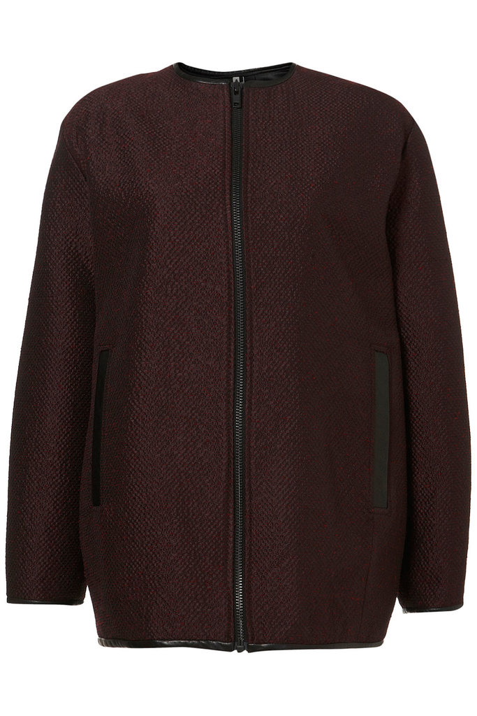 """Oxblood is the color of the season; the leather trim on this Topshop Premium Jacquard Bomber Coat ($250) makes it an easy """"must buy"""" choice."""