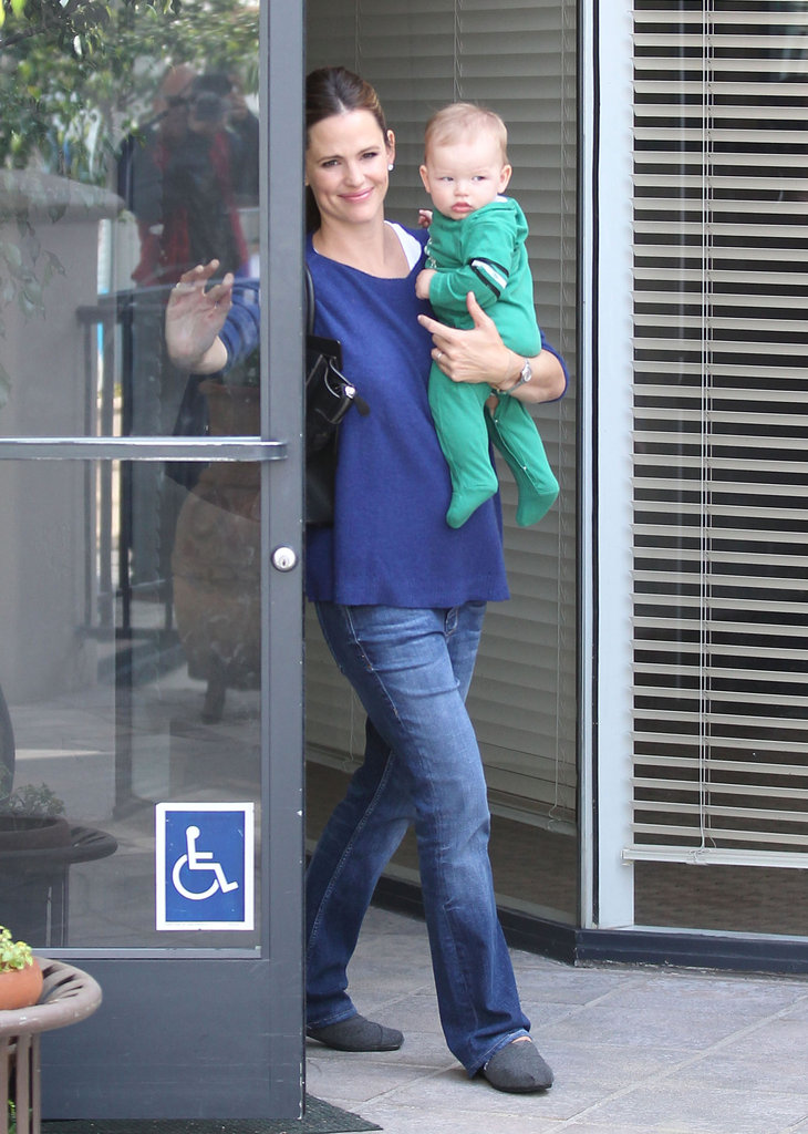 Jennifer Garner walked out of a building with Samuel Affleck in her arms.