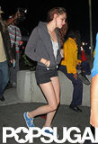 Kristen Stewart wore a pair of blue sneakers with short black shorts.