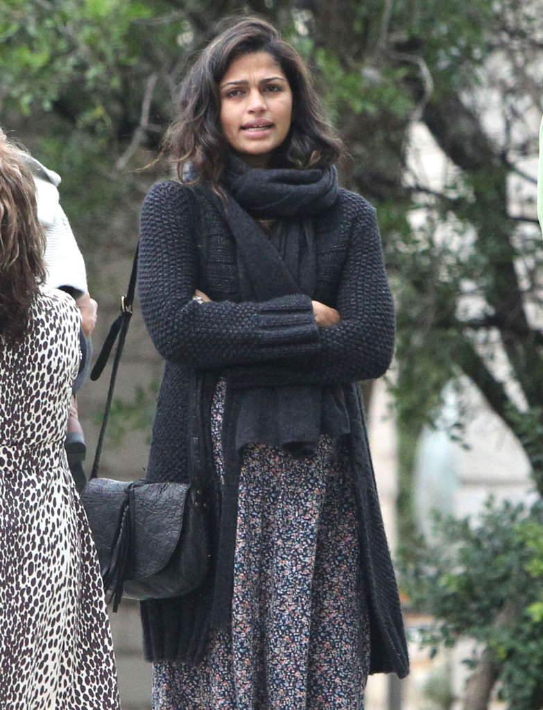Camila Alves covered up her baby bump with a sweater.