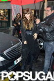 Jessica Biel was covered with an umbrella to keep dry in Paris.