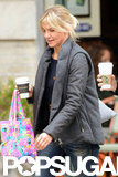 Cameron Diaz carried a coffee and a bright pink printed bag.