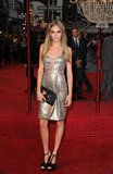 Cara Delevingne gave this ultrasexy, metallic Burberry dress a more ladylike finish with a pair of t-strap platforms.