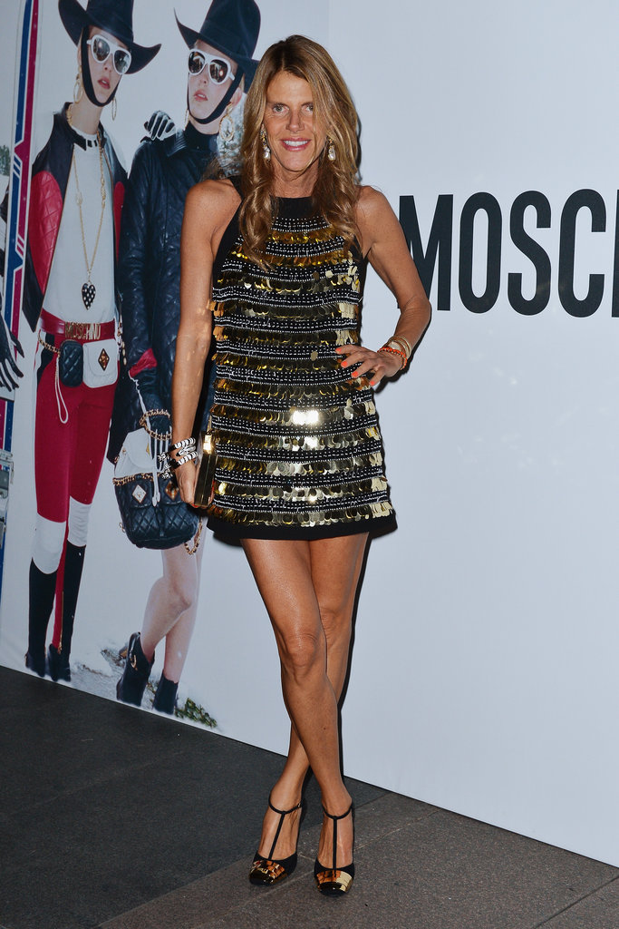 Anna Dello Russo mirrored the metallics in her dress with a pair of gold-flecked t-bar pumps.