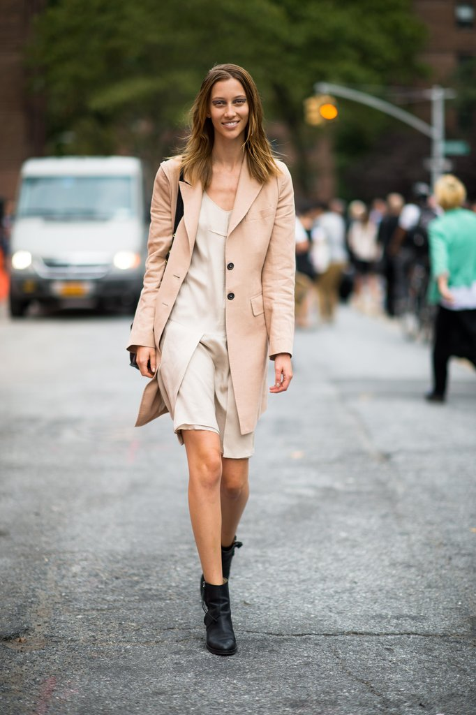 Channel soft hues that still work for Fall when you balance a girlie slipdress with a peachy coat, and anchor the look with black booties. Source: Adam Katz Sinding