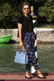 Actress Kasia Smutniak opted for a pair of sweet t-strap flats to give her floral trousers just the right finish.