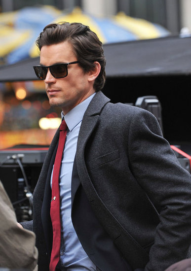 Camera-ready Matt Bomer arrived in a suit and sunglasses on the NYC set of White Collar in November 2009.