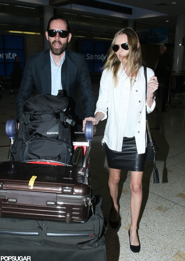 Kate Bosworth and Michael Polish walked side by side in the airport.