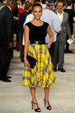 Jessica Alba finished her ladylike plaid midi skirt with a pair of classic t-strap heels.