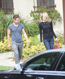 Emma Stone left a male friend's home in LA.