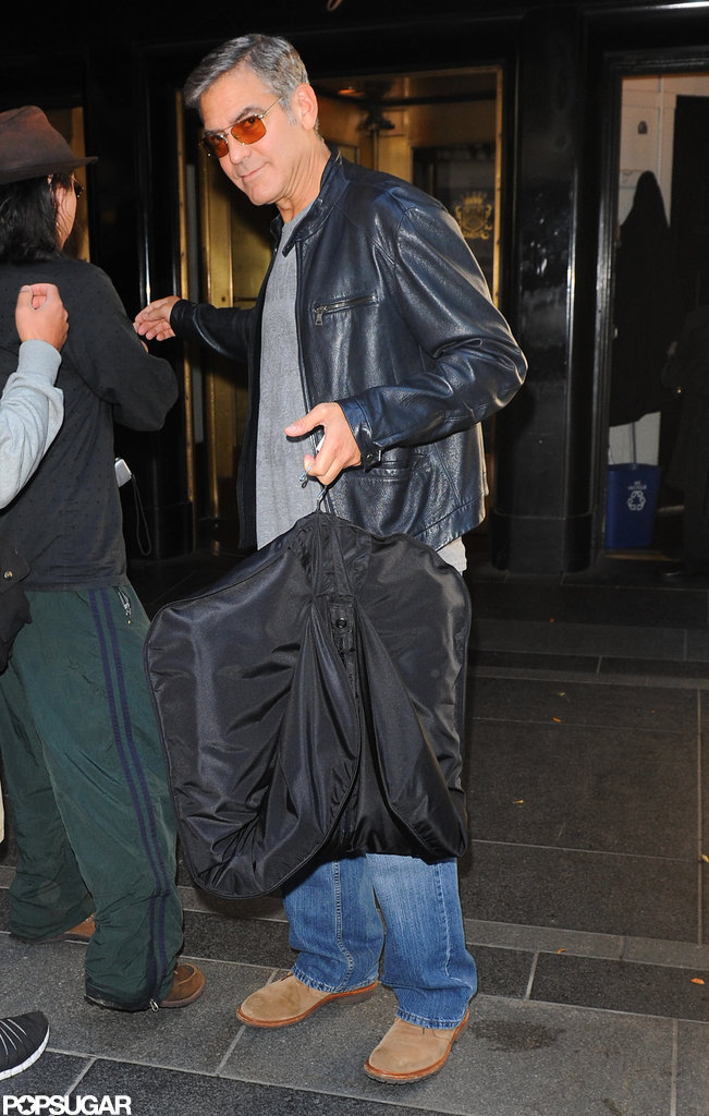 George Clooney left his hotel in NYC.