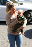 Hilary Duff wore jeans and a sweater as she ran errands with baby Luca Comrie.
