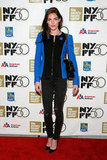 Hilary Rhoda styled cool-girl black skinnies and pumps with a punch-of-cobalt blouse at an NYC film screening.