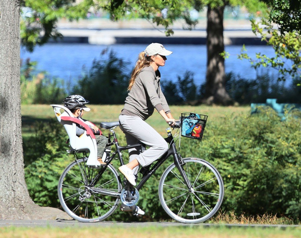 "Known for maintaining a strict exercise regime, Gisele Bundchen eagerly shared her prenatal exercise routine while pregnant with Ben, ""I did kung fu up until two weeks before Benjamin was born, and yoga three days a week.""  Now expecting her second child, she's been spotted riding a bike and leaving gym classes recently."