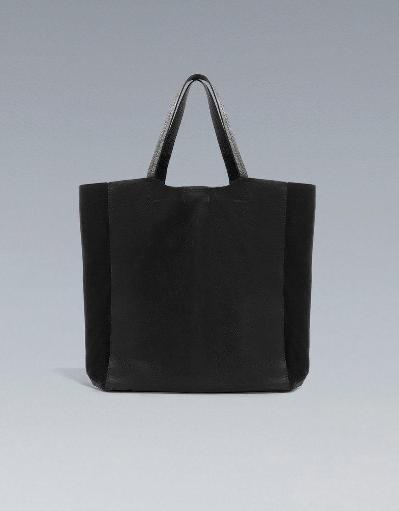 The large, structural black leather shopper from Zara ($90) provides an extra dose of cool via its subtle two-tone shading.