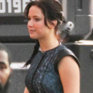 Jennifer Lawrence as Katniss Everdeen on Catching Fire Set