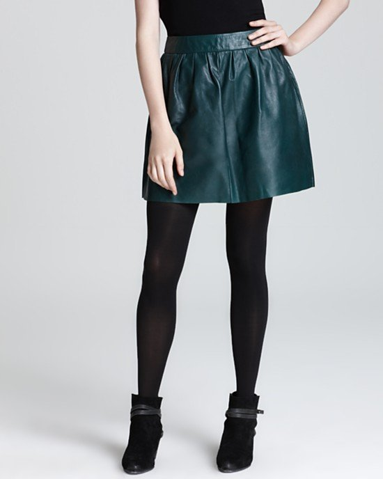 This Aqua Leather Skirt ($288) has the perfect jewel-tone hue to play off black tights.