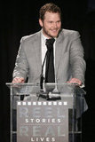 Chris Pratt had a laugh on stage at the Reel Stories, Real Lives benefit in LA.
