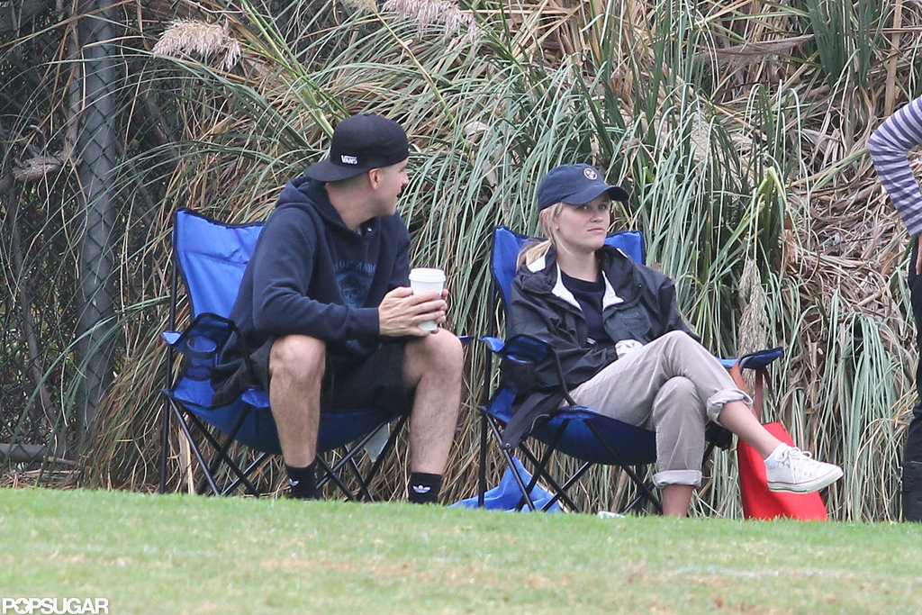 Reese Witherspoon and Jim Toth sat on the sidelines together.