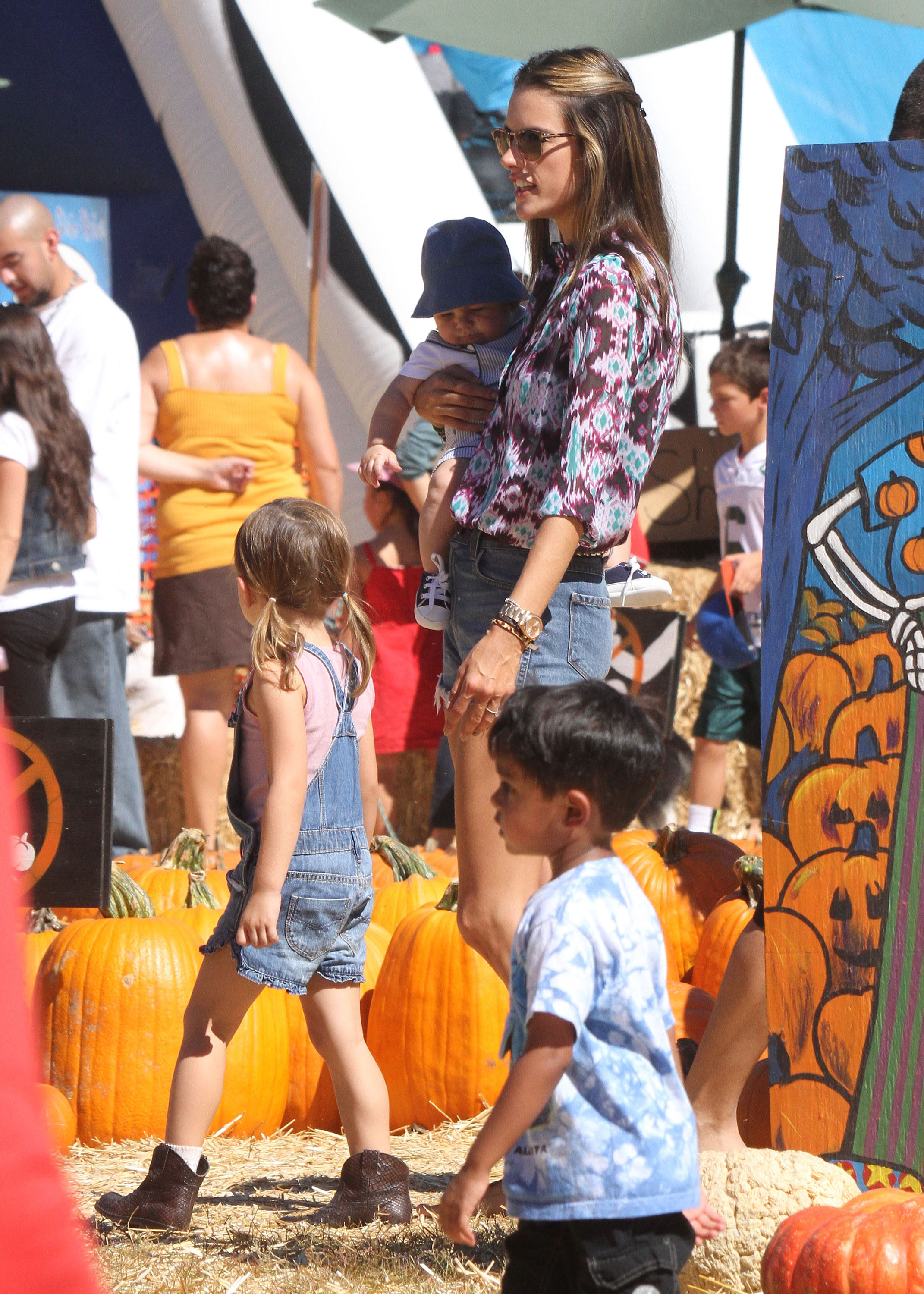 Alessandra Ambrosio showed off her legs in short cutoff shorts to accompany Anja and Noah through the pumpkin patch