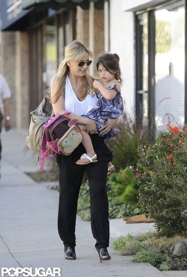 Sarah Michelle Gellar carried Charlotte Prinze, who wore a purple dress and ponytail.