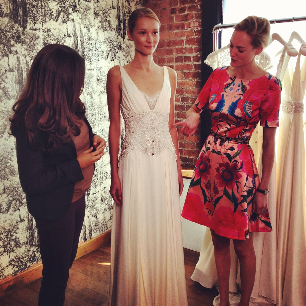 Noria and Madeleine Macey, communications director for Temperley London, talk about one of the gowns, a V-neck silk-crepe dress with a beaded bodice.