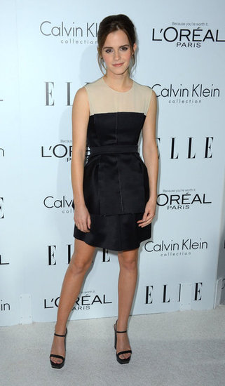 Emma Watson looked perfectly polished in a two-tone Calvin Klein dress and the label's minimalist black platforms.