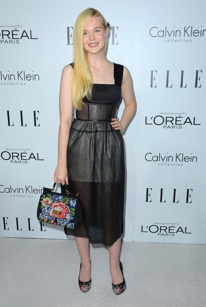 Elle Fanning offset her semisheer Calvin Klein tea-length dress with coordinated needle-point Dolce & Gabbana add-ons.