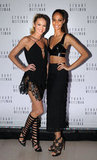 Candice Swanepoel and Joan Smalls showed off sexy black ensembles comprised of cutouts, crop bra tops, and short hemlines. How amazing are their shoes?