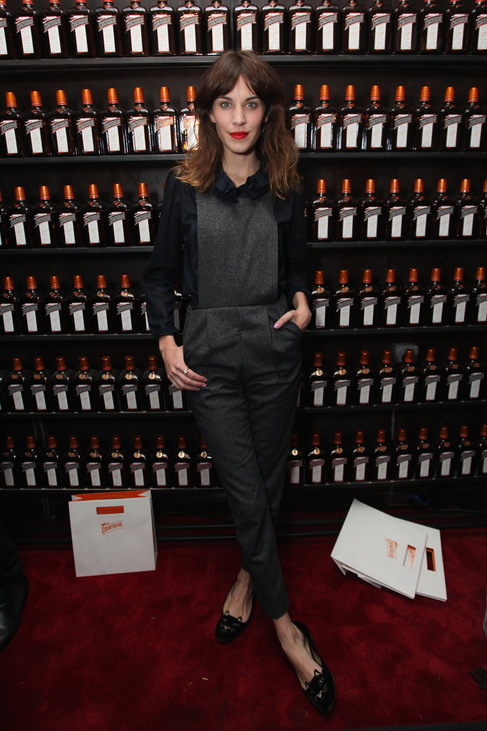 Alexa Chung put her quirky-chic spin on event dressing in a pair of Topshop overalls and Charlotte Olympia flats at the La Maison Cointreau debut party in NYC.