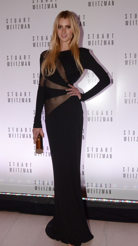 Sigrid Agren showed off her model prowess in a black, sheer long-sleeved gown.