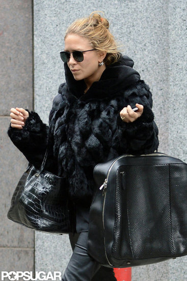 Mary-Kate Olsen pulled her hair up in a bun while shopping.