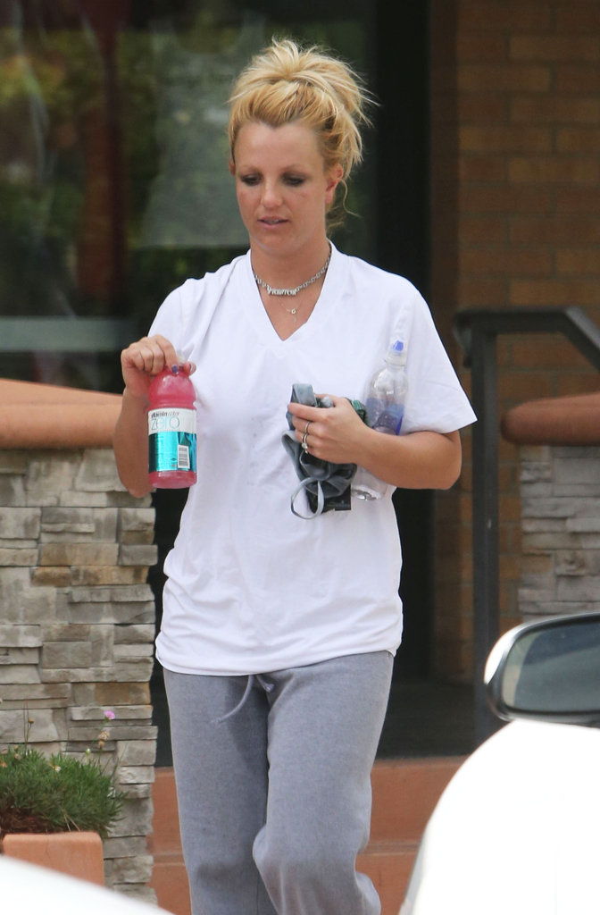 Britney Spears had her hands full as she left the gym.