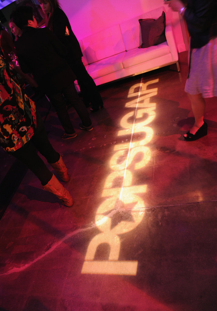 The PopSugar logo was projected across the floor.