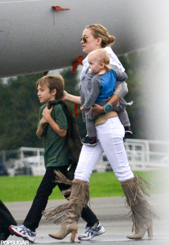 Kate Hudson wore fringe boots to spent time with sons Bingham Bellamy and Ryder Robinson.