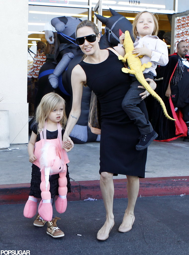 Angelina Jolie carried Knox Jolie-Pitt on her hip as she made her way out of a Halloween store in LA with Vivienne Jolie-Pitt and Shiloh Jolie-Pitt in October 2012.