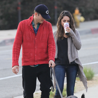 Ashton Kutcher and Mila Kunis Walking Their Dog