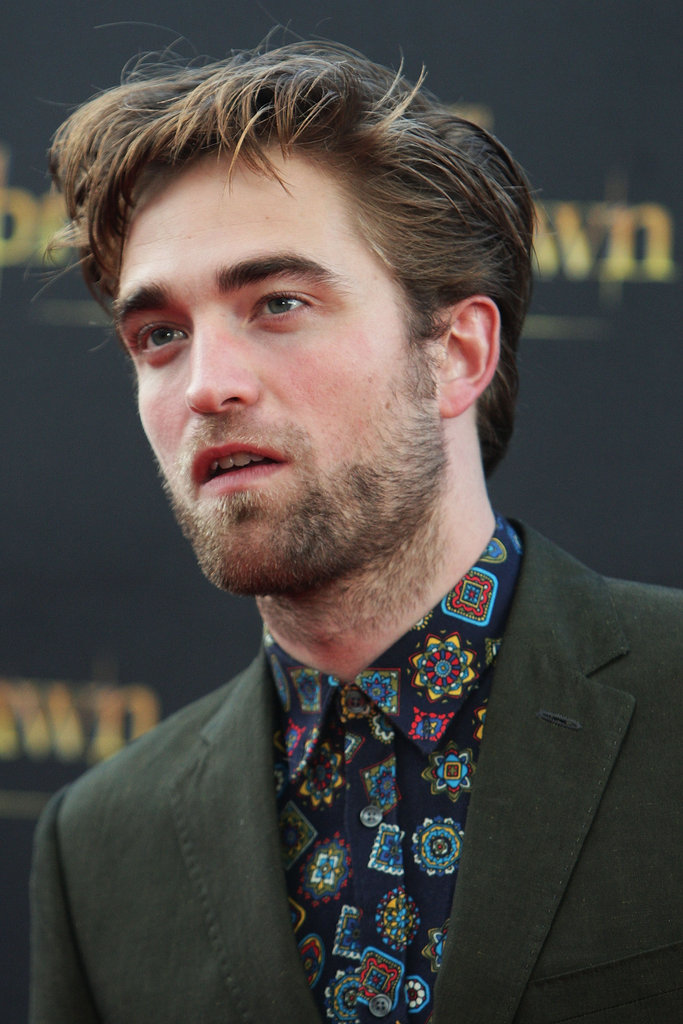 Robert Pattinson wore a printed shirt and green suit to promote Breaking Dawn - Part 2 in Sydney.