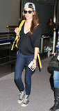 Kristen Stewart wore a yellow backback to travel to Tokyo.