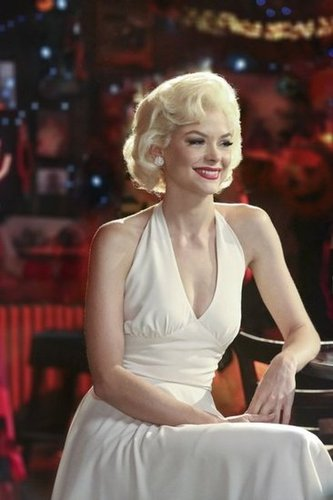 Lemon channeled Marilyn Monroe in a white halter dress and retro 'do. Work this Yigal Azrouel halter ($258, originally $860) to nail her glamour-girl look.