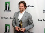 Bradley Cooper posed with his award.