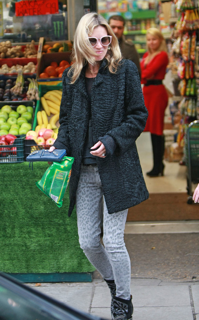 Kate Moss carried her wallet and a snack as she left a store in London.