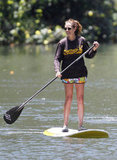 Julia Roberts went paddleboarding with a grin in Hawaii over Summer 2012.