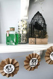 Use twine and antique lettering to easily dress up a shelf or mantel with a homemade Halloween garland. Source: The House of Smiths