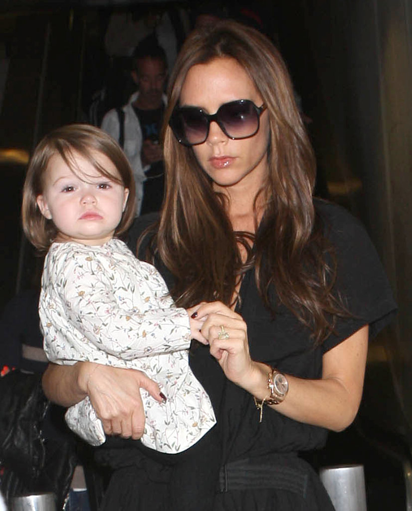 Victoria Beckham Returns to LA With Harper on Her Hip