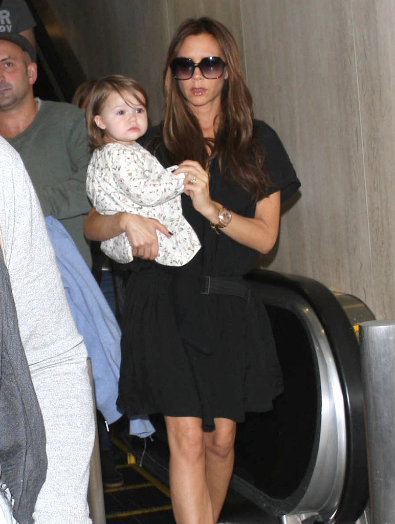 Victoria Beckham carried Harper through LAX in October.