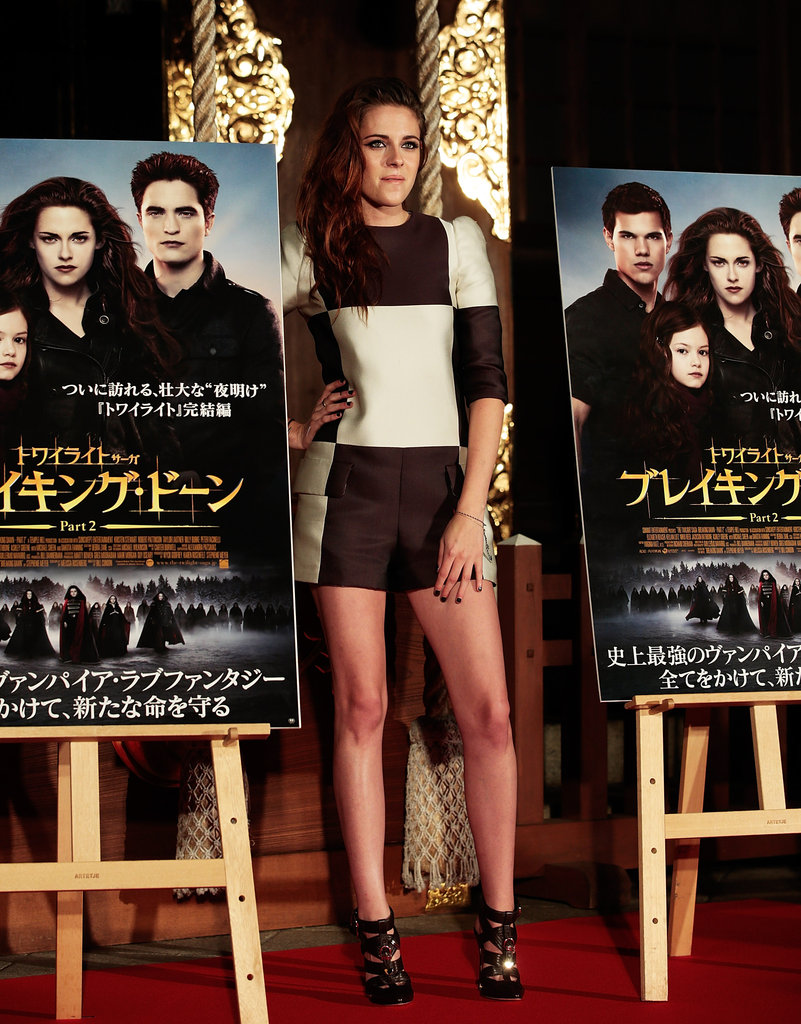 Kristen Stewart posed with movie posters at a Breaking Dawn Part 2 event in Japan.